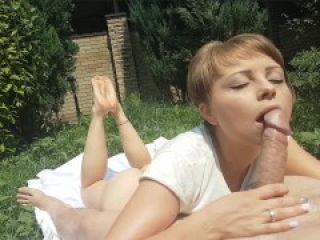 Hot slut sucks his big cock and shows her sexy feet in the yard