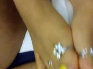 Sexy feet with yellow pedicure and ring give footjob