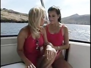 Lesbian Lifeguard Babes Having Fun On A Boat