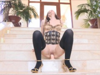 Amazing brunette with stockings is ridding a giant dildo to the orgasm in p