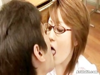 Horny Japanese teacher gets fucked and by her students in classroom